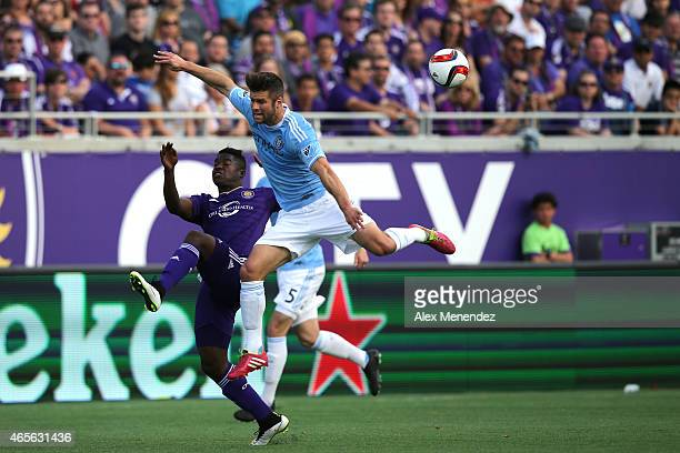 Carlos Rivas of Orlando City SC and Josh Williams of New York City FC fight for the ball during an MLS soccer match between the New York City FC and...