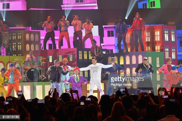 Carlos Rivera and Gente De Zona perform on stage during Univision's 'Premios Juventud' 2017 Celebrates The Hottest Musical Artists And Young Latinos...
