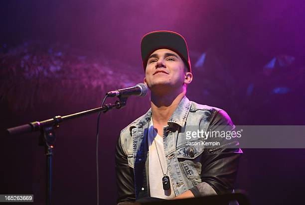Carlos Roberto Pena Jr of Big Time Rush performs at the Big Time Rush press conference and tour announcement at House of Blues on April 1 2013 in...