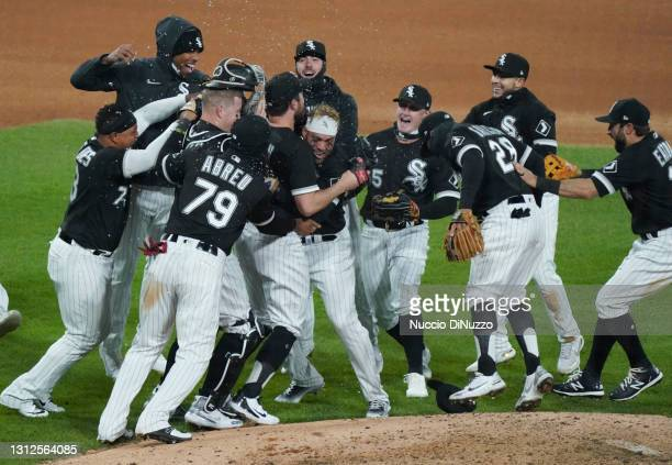 Carlos Rodon of the Chicago White Sox celebrates his no-hitter with teammates after a game against the Cleveland Indians at Guaranteed Rate Field on...