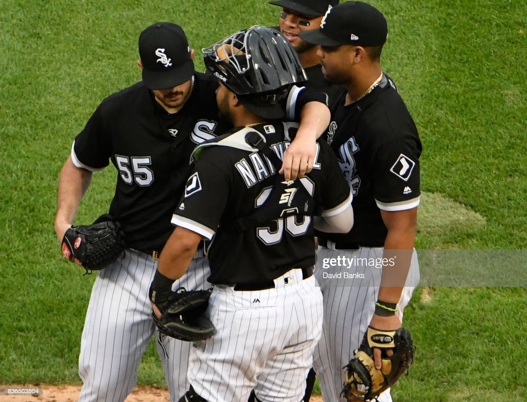 Carlos Rodon #55 of the Chicago White Sox is hugged by Omar Narvaez #38 after leaving the game during the seventh inning in game one of a doubleheader on August 21, 2017 at Guaranteed Rate Field in Chicago, Illinois.