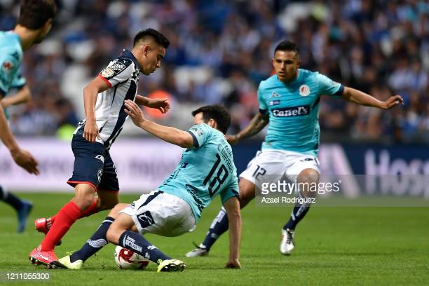 Carlos Rodríguez of Monterrey fights for the ball with Camilo Mayada of San Luis of San Luis during the 9th round match between Monterrey and...