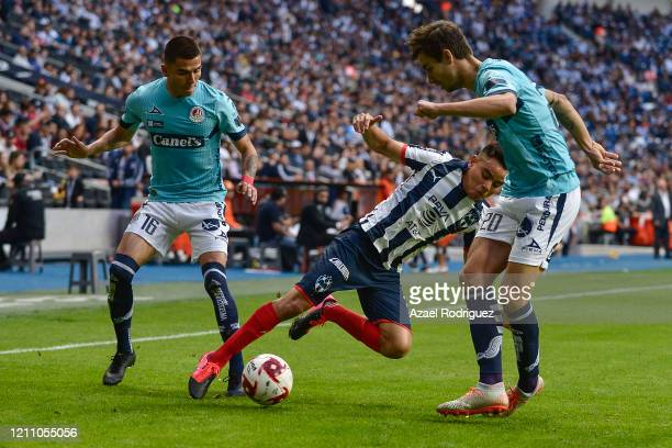 Carlos Rodríguez of Monterrey fights for the ball with Unai Bilbao and Luis Reyes of San Luis during the 9th round match between Monterrey and...