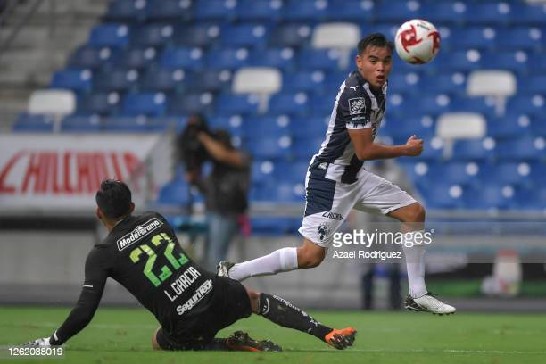 Carlos Rodríguez of Monterrey kicks the ball over Luis García of Toluca to score the second goal of his team during the 1st round match between...