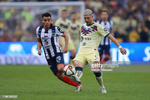 Carlos Rodríguez of Monterrey struggles for the ball against Guido Rodríguez of America during the Final second leg match between America and...