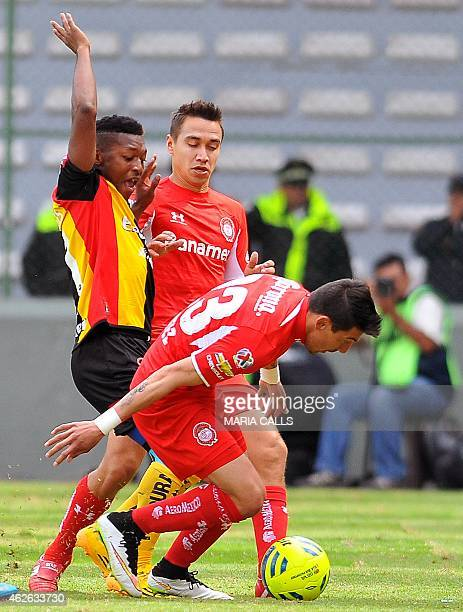 Carlos Rodriguez and Edgar Benitez of Toluca vies for the ball with Jonathan Gonzalez of Leones Negros during their Mexican Clausura tournament...