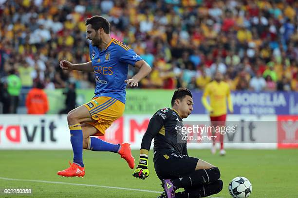 Carlos Rodriguez goalkeeper of Morelia vies for the ball with Andre Pierre Gignac of Tigres during their Mexican Apertura 2016 tournament football...