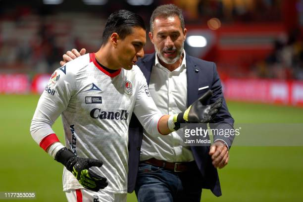 Carlos Rodriguez Goalkeeper of San Luis walks through the field with Gustavo Matosas Head Coach of San Luis during the 11th round match between...
