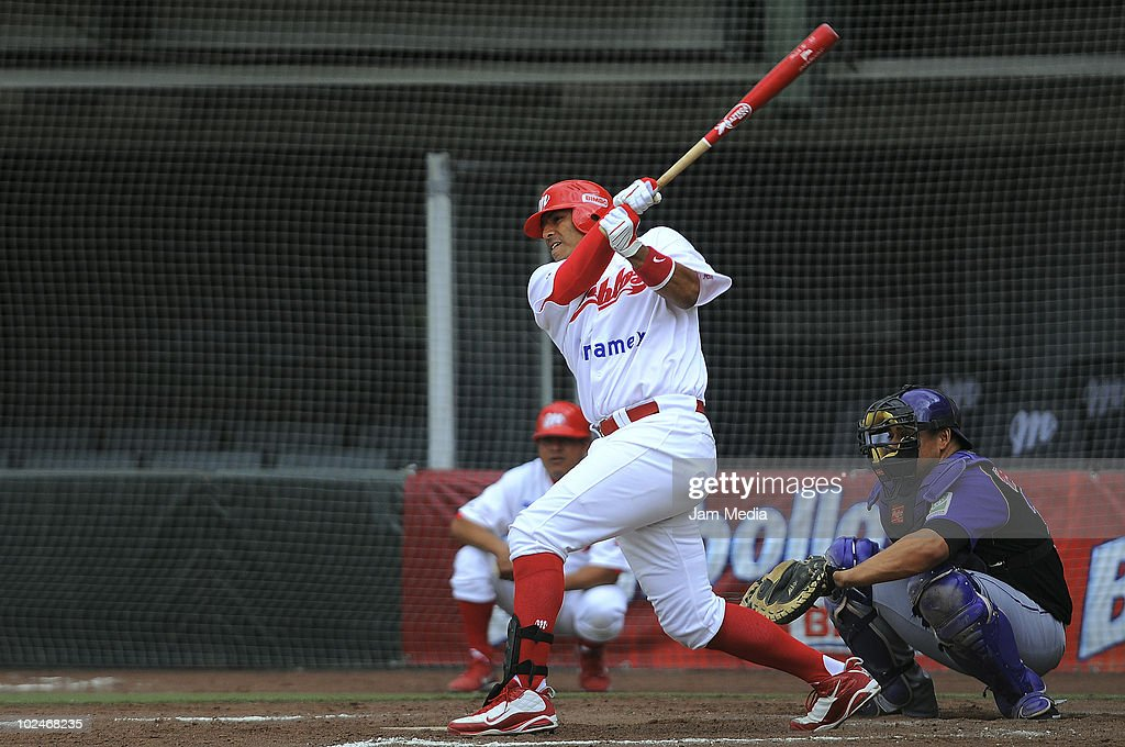 Carlos Rodriguez (R) of Dorados de Chihuahua and Miguel Ojeda (L) of Diablos Rojos in action during a match as part of the 2010 Mexican Baseball League at Foro Sol Stadium on June 26, 2010 in Mexico City, Mexico.