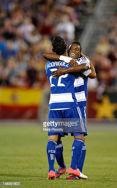 Carlos Rodriguez of FC Dallas gets a hug from teammate Fabian Castillo after Rodriguez scored a goal to tie the game against the Colorado Rapids at...