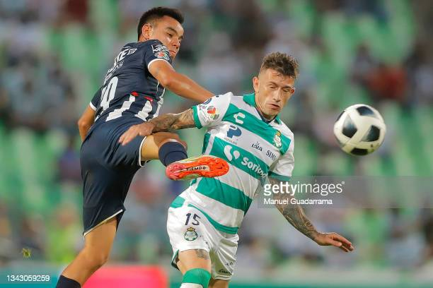 Carlos Rodriguez of Monterrey fights for the ball with Brian Lozano of Santos during the 10th round match between Santos Laguna and Monterey as part...