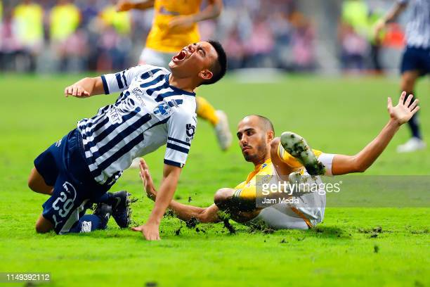 Carlos Rodriguez of Monterrey fights for the ball with Guido Pizarro of Tigres during the semifinals first leg match between Monterrey and Tigres...