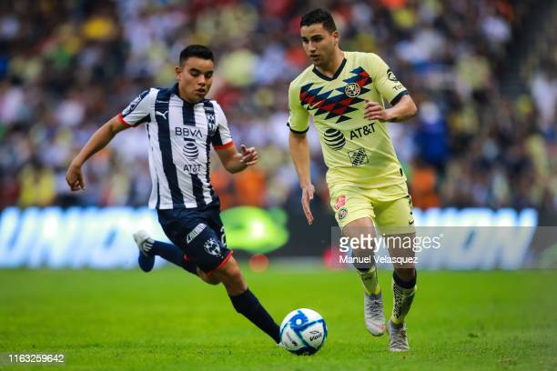Carlos Rodriguez of Monterrey struggle for the ball against Jorge Sanchez of America during the 1st round match between America and Monterrey as part...