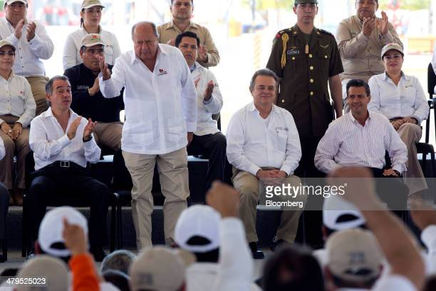 Carlos Romero Deschamps president of Mexico's oil worker's union standing gestures to attendees during an event to celebrate the anniversary of the...