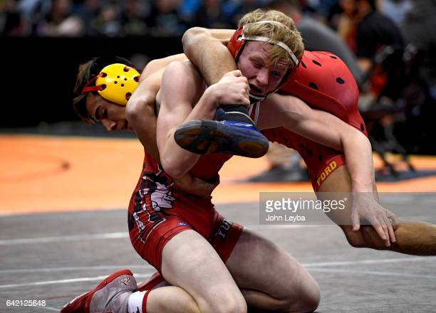 Carlos Romo of Rocky Ford and Spencer Holtorf of Yuma get tangled up during their 2A 138 pound match in the Colorado high school state wrestling...