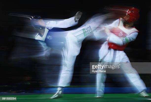 Carlos Ruben Navarro Valdez of Mexico kicks Yousef Shriha of Libya during the Taekwondo Men's 58kg Round One contest on Day 11 of the Rio 2016...