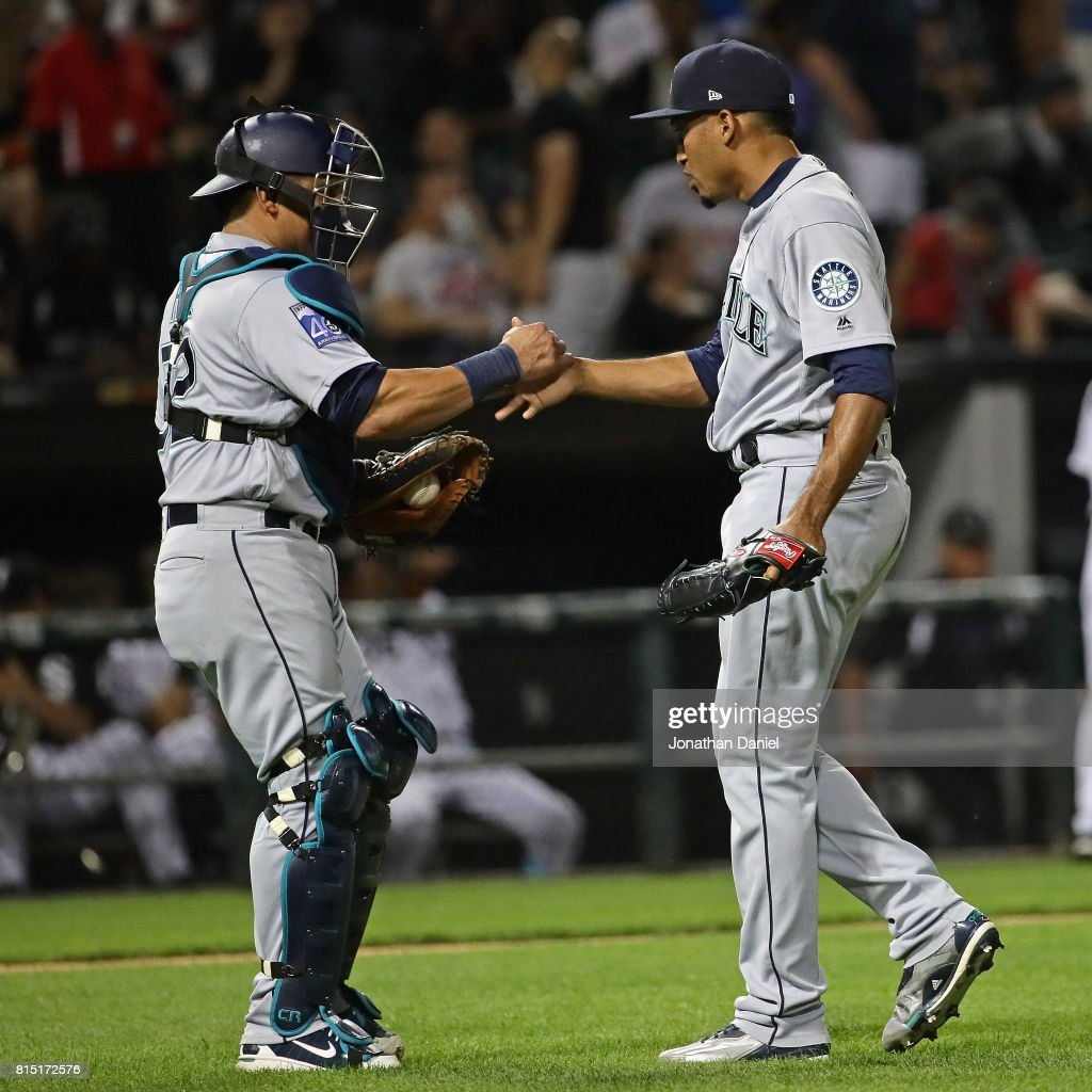 Carlos Ruiz #52 (L) and Edwin Diaz #39 of the Seattle Mariners shake hands after a win over the Chicago White Sox at Guaranteed Rate Field on July 15, 2017 in Chicago, Illinois. The Mariners defeated the White Sox 4-3.