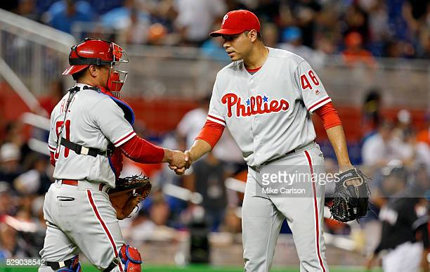 Carlos Ruiz congratulates pitcher Jeanmar Gomez of the Philadelphia Phillies on his save at the end of the ninth inning of a game against the Miami...