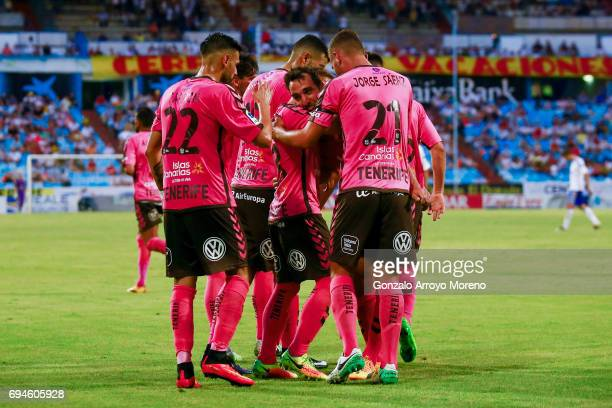 Carlos Ruiz of CD Tenerife celebrates scoring their second goal with teammates during the La Liga 2 match between Real Zaragoza and CD Tenerife at La...