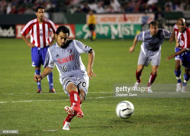 Carlos Ruiz of FC Dallas scores his teams' second goal on a penalty kick against Chivas USA on April 16, 2005 at the Home Depot Center in Carson,...