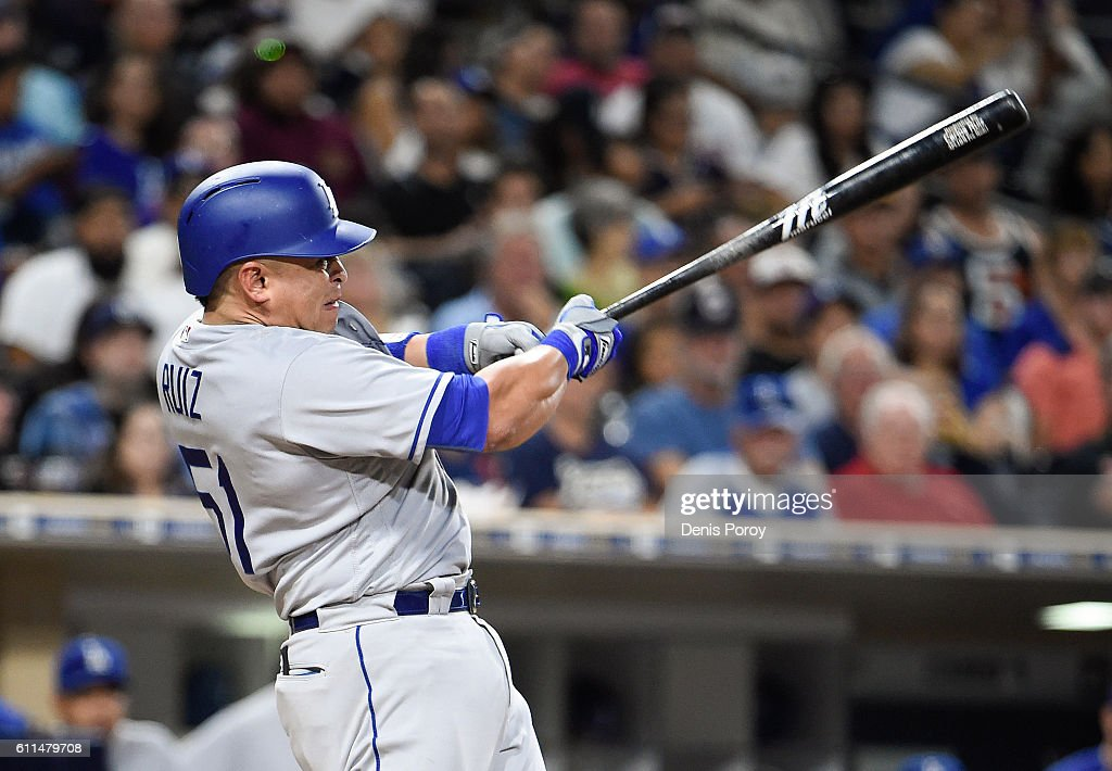 Carlos Ruiz #51 of the Los Angeles Dodgers hits an RBI double during the seventh inning of a baseball game against the San Diego Padres at PETCO Park on September 29, 2016 in San Diego, California.
