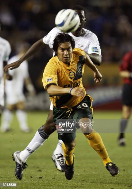 Carlos Ruiz of the Los Angeles Galaxy chases the ball down in front of Daouda Kante of the New England Revolution during their MLS game on April 3...