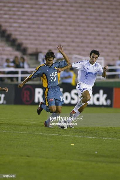 Carlos Ruiz of the Los Angeles Galaxy fends off Kerry Zavagnin of the Kansas City Wizards during the first half on August 21 2002 at the Rose Bowl in...