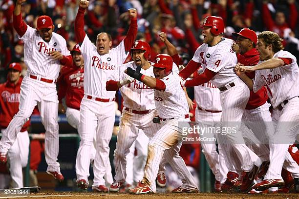 Carlos Ruiz of the Philadelphia Phillies celebrates with his teammates after he scored the winning run on a walkoff 2-run double by Jimmy Rollins...