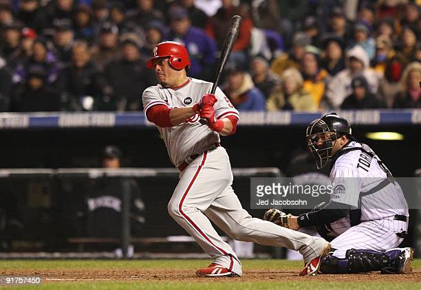 Carlos Ruiz of the Philadelphia Phillies hits a RBI single against the Colorado Rockies in the fourth inning in Game Three of the NLDS during the...