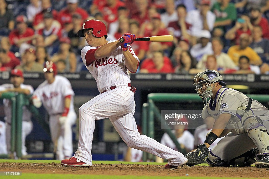 Carlos Ruiz #51 of the Philadelphia Phillies hits an RBI double in the ninth inning during a game against the Colorado Rockies at Citizens Bank Park on August 21, 2013 in Philadelphia, Pennsylvania. The Phillies won 4-3.