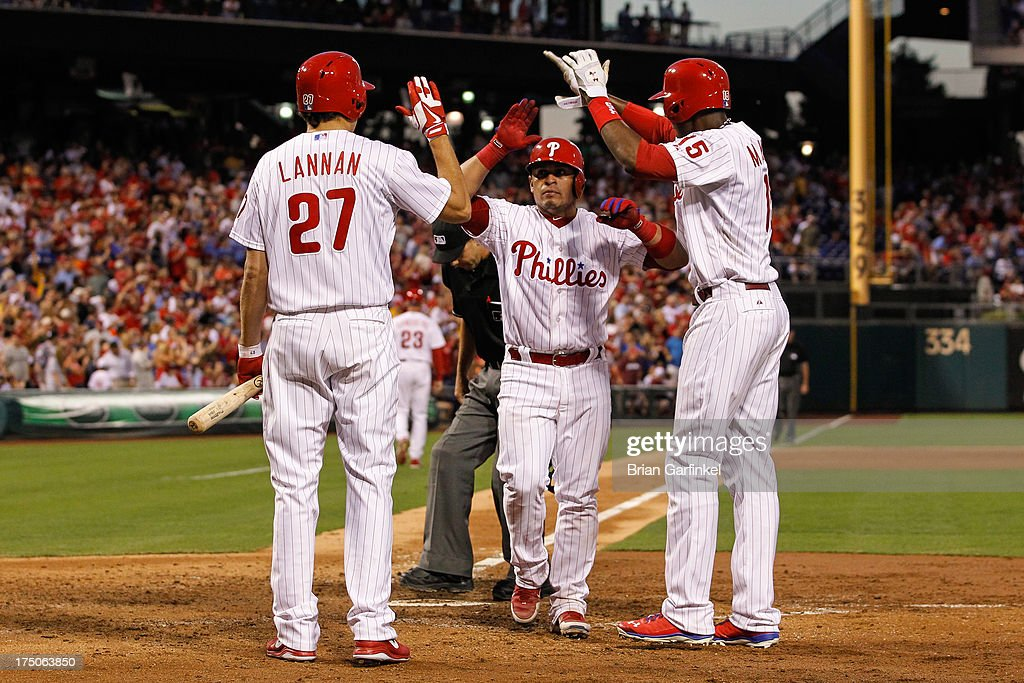 Carlos Ruiz #51 of the Philadelphia Phillies is congratulated by teammates at the plate after hitting a two run home run in the fourth inning of the game against the San Francisco Giants at Citizens Bank Park on July 30, 2013 in Philadelphia, Pennsylvania.