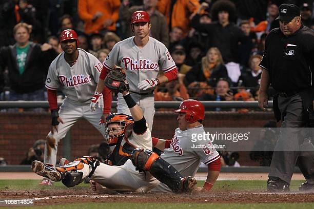 Carlos Ruiz of the Philadelphia Phillies is tagged out at home plate by Buster Posey of the San Francisco Giants in the fifth inning of Game Four of...