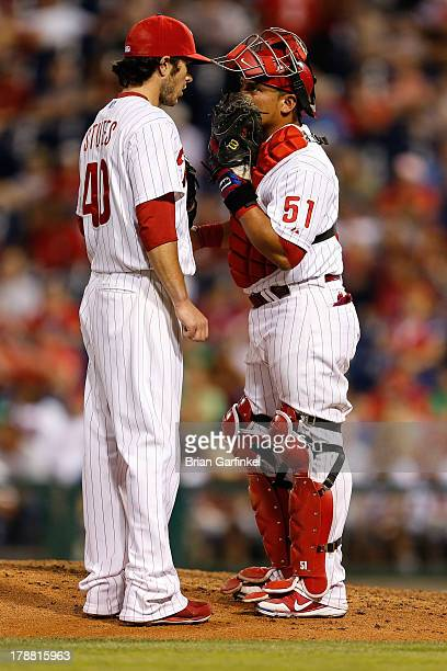 Carlos Ruiz of the Philadelphia Phillies meets on the mound with Michael Stutes during the game against the Washington Nationals at Citizens Bank...