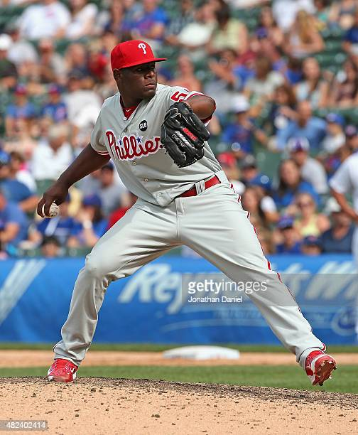 Carlos Ruiz of the Philadelphia Phillies pitches against the Chicago Cubs at Wrigley Field on July 26 2015 in Chicago Illinois The Phillies defeated...