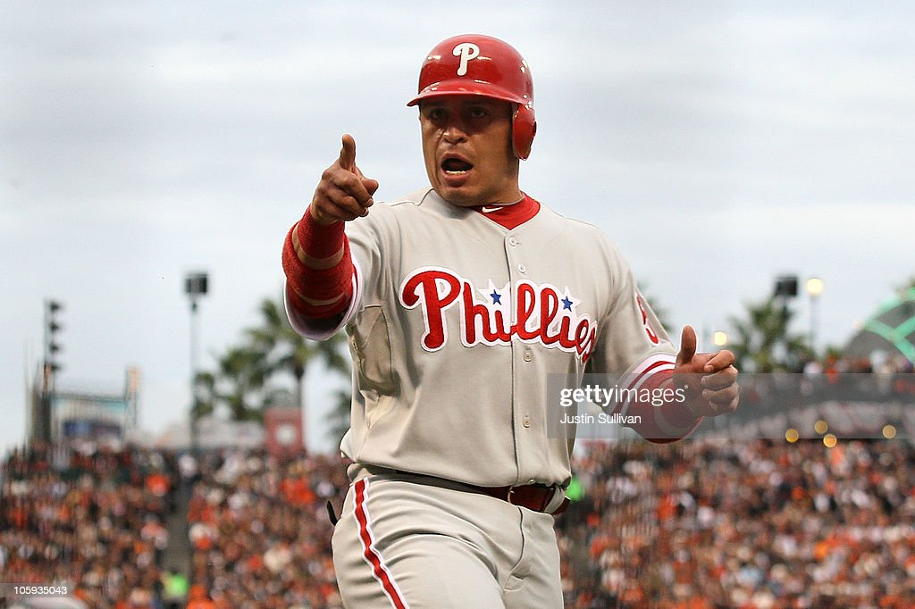 Carlos Ruiz #51 of the Philadelphia Phillies reacts after scoring in the third inning against the San Francisco Giants in Game Five of the NLCS during the 2010 MLB Playoffs at AT&T Park on October 21, 2010 in San Francisco, California.
