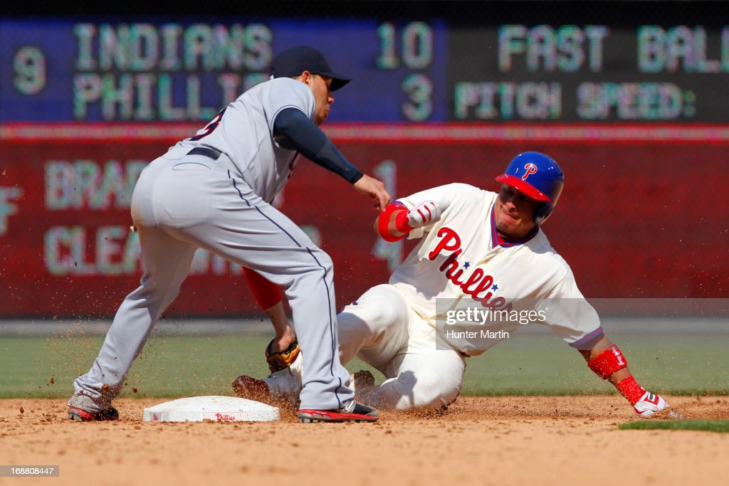Carlos Ruiz #51 of the Philadelphia Phillies slides into second base under the tag of Asdrubal Cabrera #13 of the Cleveland Indians during a game at Citizens Bank Park on May 15, 2013 in Philadelphia, Pennsylvania. The Indians won 10-4.
