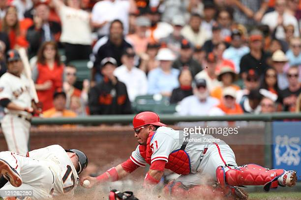 Carlos Ruiz of the Philadelphia Phillies tags out Aubrey Huff of the San Francisco Giants at home during the game at ATT Park on August 7 2011 in San...