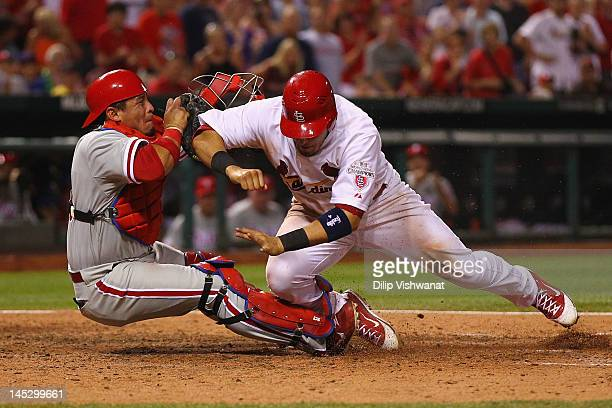 Carlos Ruiz of the Philadelphia Phillies tags out Yadier Molina of the St Louis Cardinals at Busch Stadium on May 25 2012 in St Louis Missouri