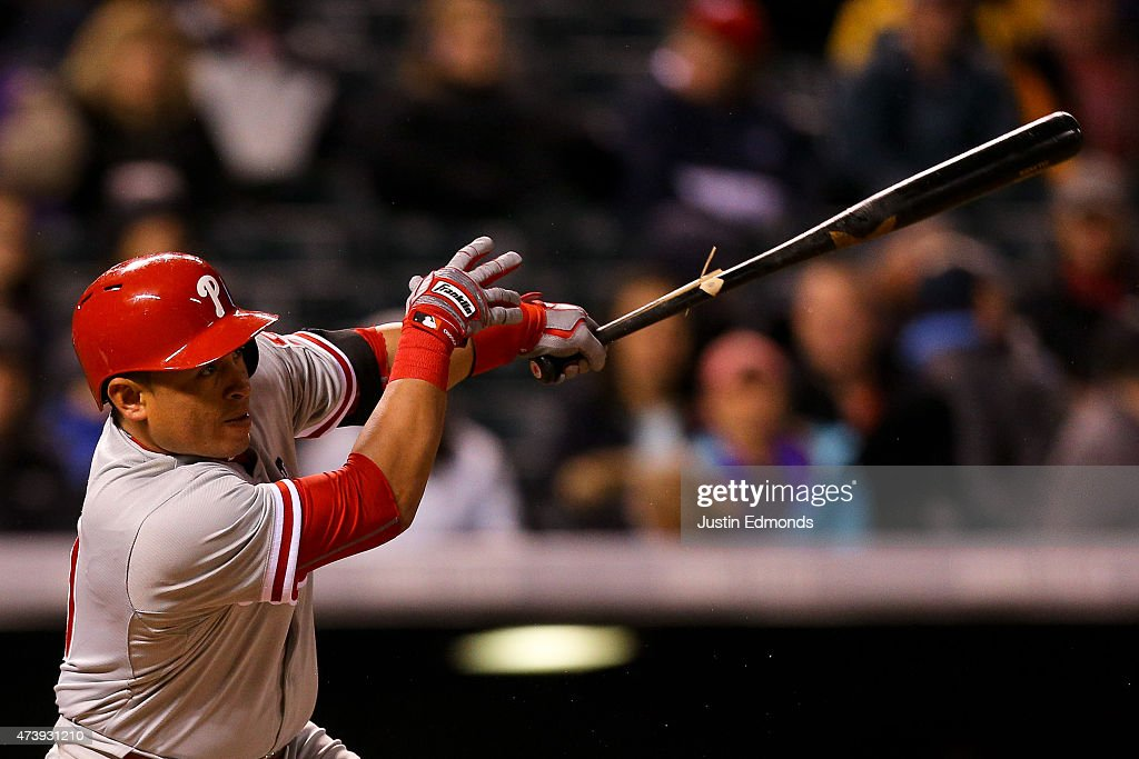 Carlos Ruiz #51 of the Philadelphia Phillies watches his RBI single during the sixth inning against the Colorado Rockies at Coors Field on May 18, 2015 in Denver, Colorado.