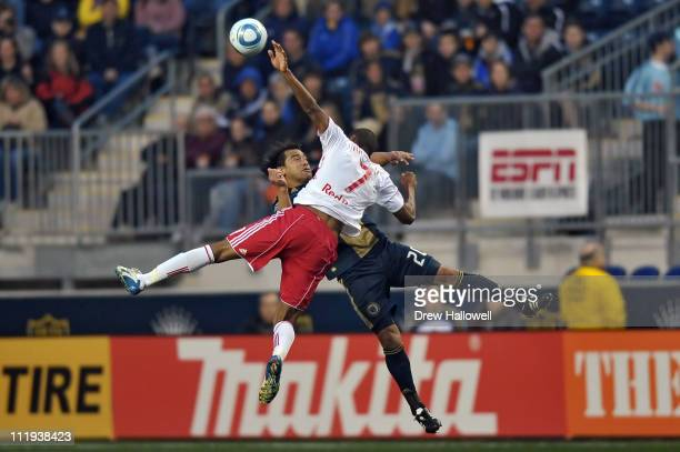 Carlos Ruiz of the Philadelphia Union and Roy Miller of the New York Red Bulls collide going for the ball at PPL Park on April 9, 2011 in Chester,...