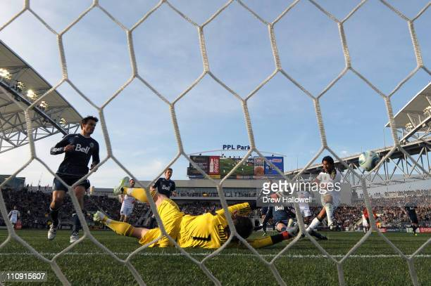 Carlos Ruiz of the Philadelphia Union shoots and scores the game winning goal past goalkeeper Joe Cannon of the Vancouver Whitecaps at PPL Park on...