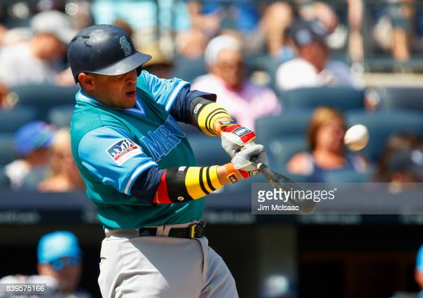 Carlos Ruiz of the Seattle Mariners connects on a second inning home run against the New York Yankees at Yankee Stadium on August 26 2017 in the...