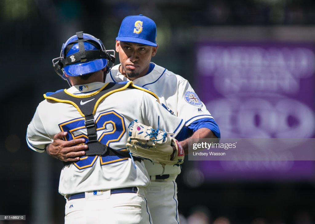 Carlos Ruiz #52 of the Seattle Mariners hugs Edwin Diaz #39 after Diaz struck out Ryon Healy #25 of the Oakland Athletics to win the game at Safeco Field on July 9, 2017 in Seattle, Washington. The Seattle Mariners beat the Oakland Athletics 4-0.