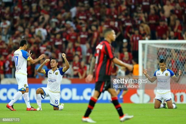 Carlos Ruiz Peralta Alexis Gonzalez and Ramon Ortigoza of Paraguay's Deportivo Capiata celebrate after their Libertadores Cup football match with...