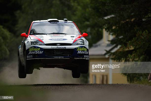Carlos Saintz of Spain and the Ford Focus RS WRC team in action during second leg of the Neste Rally of Finland the ninth race of the World Rally...