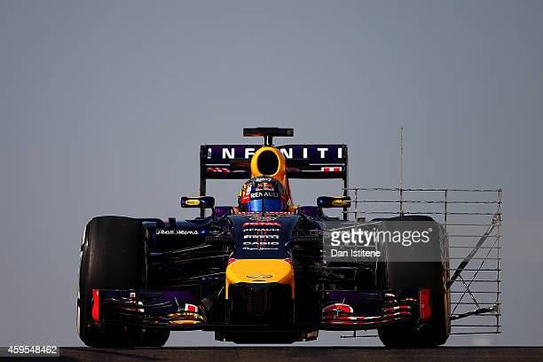 Carlos Sainz Jr of Spain and Infiniti Red Bull Racing drives during day one of Formula One testing at Yas Marina Circuit on November 25 2014 in Abu...