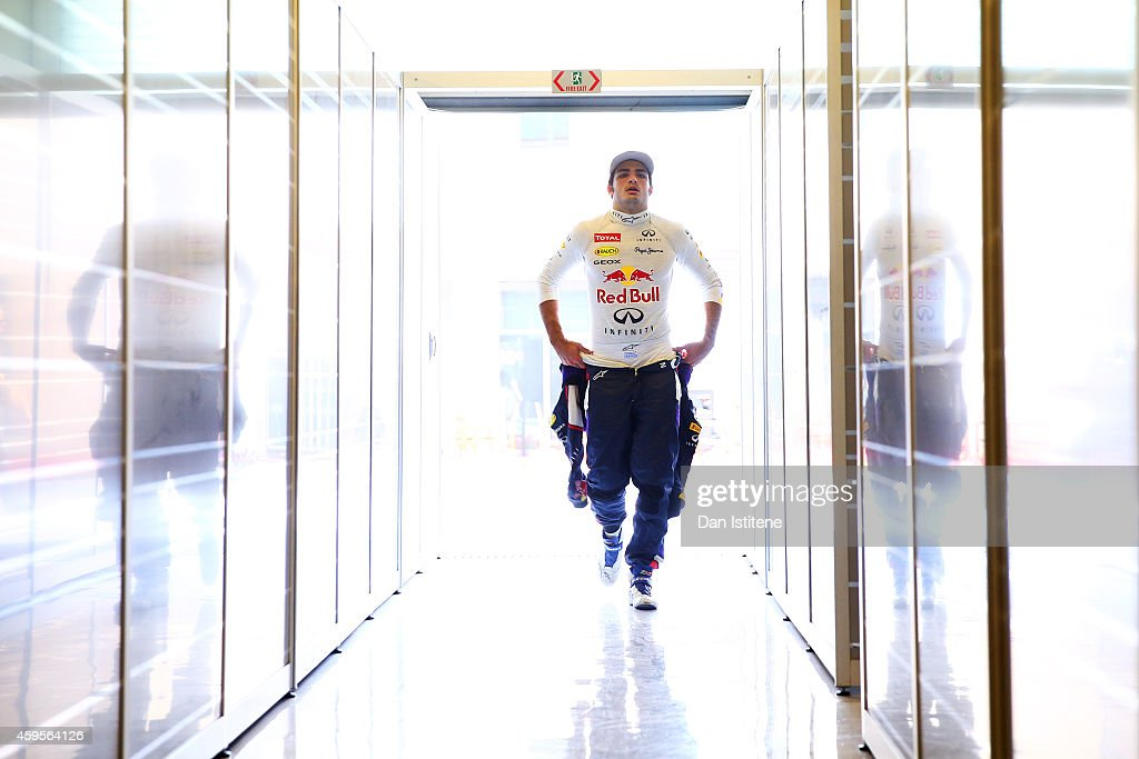Carlos Sainz Jr. of Spain and Infiniti Red Bull Racing walks into the garage during day one of Formula One testing at Yas Marina Circuit on November 25, 2014 in Abu Dhabi, United Arab Emirates.