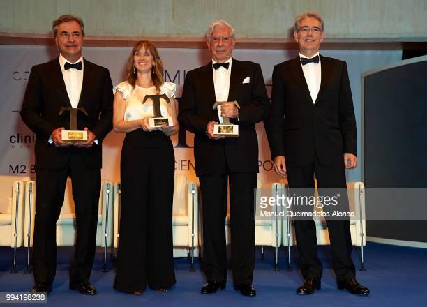 Carlos Sainz Maite Mendioroz Mario Vargas LLosa and Telva magazine president Antonio FernandezGaliano attend Arts Sciences and Sports Telva Awards...