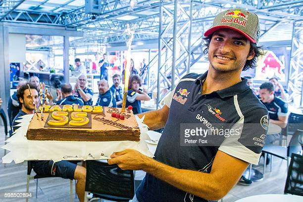 Carlos Sainz of Scuderia Toro Rosso and Spain celebrates his 22nd birthday during previews for the Formula One Grand Prix of Italy at Autodromo di...