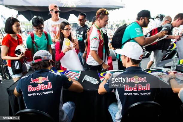 Carlos Sainz of Scuderia Toro Rosso and Spain Pierre Gasly of Scuderia Toro Rosso and France during the Malaysia Formula One Grand Prix at Sepang...
